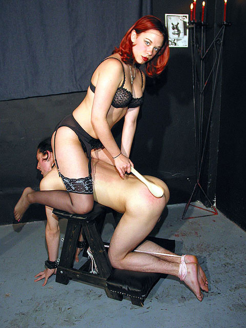 Woman using suction cup dildos